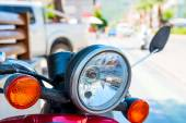 Headlight red motorcycle shot close-up on the street — Stock Photo