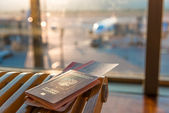 Passports and tickets on a background of an airplane — Stock Photo