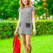 Barefoot girl walking on the grass in the park — Stock Photo #60500109