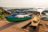 Fishing boats with nets by the ocean — Stock Photo