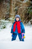Cheerful boy 4 years old laughing in winter — Stock Photo
