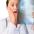 Shocked doctor with x-ray ill patient — Stock Photo #67145349