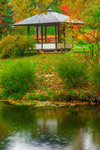 Gazebo in the empty autumn park near the pond — Foto Stock