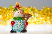 Figurine snowman and tinsel - decorations for Christmas — Stock Photo