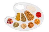Palette for paints stuffed cereals and spices — Stock Photo