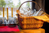 Basket with empty glasses on the kitchen table — Stock Photo