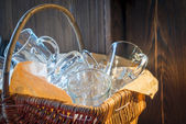 Clean beer glasses in a wicker basket — Stock Photo