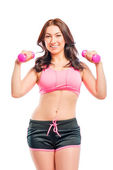 Portrait of a beautiful trainer with dumbbells on a white backgr — Stock Photo