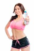 Athlete with water bottle on a white background — Stock Photo