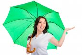 Portrait of a smiling happy girl with a green umbrella isolated — Stock Photo