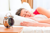 Woman sleeping peacefully in the morning — Stock Photo