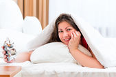 Woman with an alarm clock and a good start of the day — Stock Photo