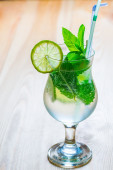 Glass of cool mojito on a wooden table — Stock Photo
