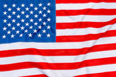 American flag fills the frame completely and fluttering in the w — Stock Photo