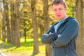 Portrait of a 30 year old trainer in a sports suit outdoors — Stock Photo