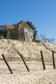 House with poles erosion at Beach — 图库照片