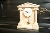 Elegant antique clock. Clock with Greek temple. Marble clock on black piano — Stock Photo