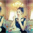 Fashionable attractive young woman in black dress eating macaroons in restaurant. Beautiful brunette holding cookies in elegant vintage scenery. Attractive lady with creative haircut eating cakes — Stock Photo #54724219