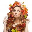 Autumnal woman. Beautiful creative makeup and hair style in fall concept studio shot. Beauty fashion model girl with autumnal make up and hair style. Fall. Creative Autumn makeup. Gorgeous redhead. — Stock Photo #57089797