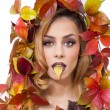 Autumnal woman. Beautiful creative makeup and hair style in fall concept studio shot. Beauty fashion model girl with autumnal make up and hair style. Fall. Creative Autumn makeup. Gorgeous redhead. — Stock Photo #57574419