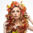 Autumnal woman. Beautiful creative makeup and hair style in fall concept studio shot. Beauty fashion model girl with autumnal make up and hair style. Fall. Creative Autumn makeup. Gorgeous redhead. — Stock Photo #57574423