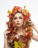 Autumnal woman. Beautiful creative makeup and hair style in fall concept studio shot. Beauty fashion model girl with autumnal make up and hair style. Fall. Creative Autumn makeup. Gorgeous redhead. — Stock Photo