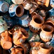 Romanian traditional pottery handcrafted mugs at a souvenir shop. Romanian traditional handcrafted pottery plates and jugs — Stock Photo #58155905
