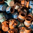 Romanian traditional pottery handcrafted mugs at a souvenir shop. Romanian traditional handcrafted pottery plates and jugs — Stock Photo #58155907