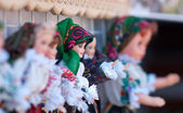 Romanian traditional colorful handmade dolls, close up. Dolls to be sold at souvenir market in Romania. Gift dolls. — Stock Photo