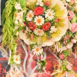 Colorful artificial flowers decorations. Decorative arrangement of various flowers at Romanian market — Stock Photo #58666663
