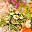 Colorful artificial flowers decorations. Decorative arrangement of various flowers at Romanian market — Stock Photo #58666683