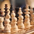 Black and white chess pieces on a chessboard, closeup. Set of chess figures on the playing board — Stock Photo #58666729