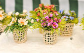 Colorful artificial flowers decorations. Decorative arrangement of various flowers at Romanian market — Stock Photo