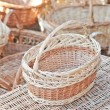 Handmade baskets for sale at a souvenir market in Romania. Traditional Romanian handmade wood baskets — Stock Photo #58761703