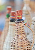 Close up of demijohn bottles with corn cob plug at souvenir market in Romania — Stock Photo
