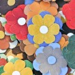 Colorful artificial flowers decorations. Decorative arrangement of various flowers at Romanian market. Colorful textile flowers as background — Stock Photo #58884809
