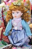 Red hair doll to be sold at souvenir market in Romania. Gift doll. Romanian traditional colorful handmade doll — Stock Photo