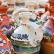 Romanian traditional pottery handcrafted mugs at a souvenir shop. Romanian traditional handcrafted pottery jugs to be sold at the market — Stock Photo #59136399