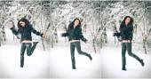 Attractive brunette girl in black posing playing in winter scenery. Beautiful young woman with long hair enjoying the snow. Long legs young woman jumping laughing in wintertime outdoor — Stock Photo