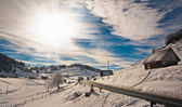 Majestic sunset in the mountains landscape. Sunset landscape in Carpathian mountains. Dawn in mountains Carpathians, Romania. Mountains covered with snow. Mountain road — Stock Photo