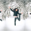 View of happy brunette girl playing with snow in winter landscape. Beautiful young female on winter background. Attractive young woman in warm soft clothes outdoor in a winter day — Stock Photo #61999323