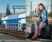Sexy attractive girl with red head boots posing on the platform in railway station. Blonde woman in blue jeans jacket sitting on suitcase waiting for the train. Retro-styled female in railway station — Stock Photo