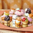 Wedding decoration with colored cupcakes, meringues and muffins. Elegant and luxurious event arrangement with colorful cakes. Wedding dessert. Set of tasty mini cakes on table — Stock Photo #72536029