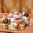 Wedding decoration with colored cupcakes, meringues and muffins. Elegant and luxurious event arrangement with colorful cakes. Wedding dessert. Set of tasty mini cakes on table — Stock Photo #72536033