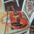 Classic music violin vintage close up. Violin on chair — Stock Photo #73219219