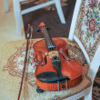 Classic music violin vintage close up. Violin on chair — Stock Photo #73219221