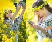 Woman wearing Romanian traditional blouse taking a selfie with a camera and checking her smart phone in canola field, outdoor shot. Portrait of beautiful blonde enjoying the yellow flowers of rapeseed — Stock Photo