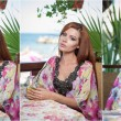 Attractive red hair young woman with bright colored blouse drinking lemonade on a terrace having blue sea in background. Gorgeous redhead model drinking fresh drink with straw in a summer day — Stock Photo #75947759