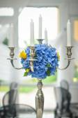 Antique candlestick with blue flowers wedding bouquet. Wedding candlestick with flower decoration before wedding ceremony. Table set for a wedding reception — Stock Photo