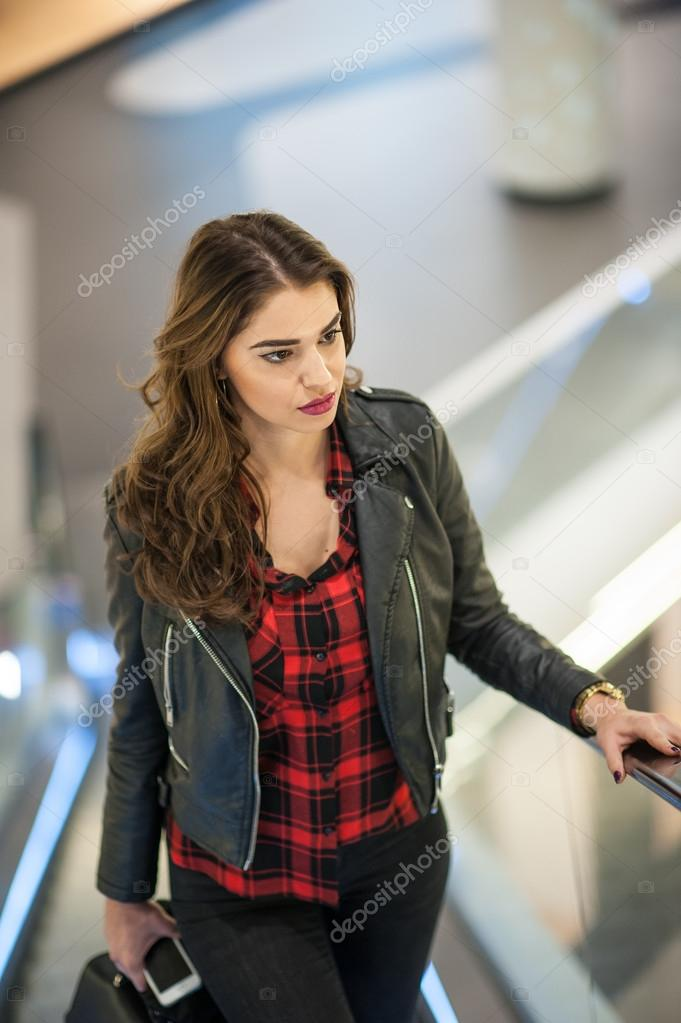 Attractive young woman fashion shot in mall. Beautiful fashionable ...